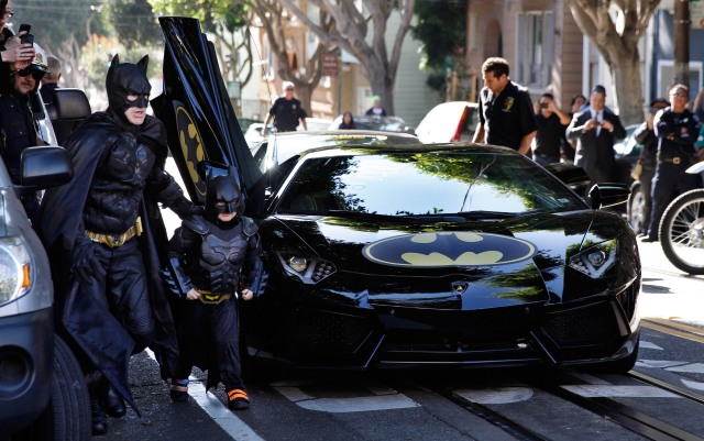 "Five-years-old Miles, from Tule Lake, Calif., is dressed in a Batman costume in San Francisco, Friday, November 14, 2014. Miles, who wants to be a Batman, will embark on a series of crime-solving adventures when San Francisco is converted into ""Gotham City"" as part of a Make-A-Wish Foundation event. He is in a fight on his own in his battle against leukemia since he was a year old. He is now in remission. (Photo: Make-A-Wish Foundation/PaulSakuma.com)"