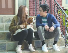 "Kathryn Prescott and Henry Lau in ""A Dog's Journey."" (Universal Pictures)"